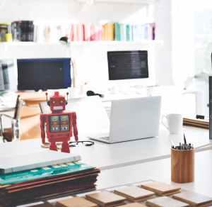white laptop computer on white desk